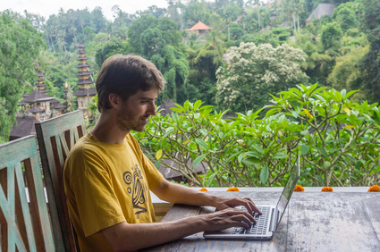 Man working on laptop in Ubud, Bali, Indonesia